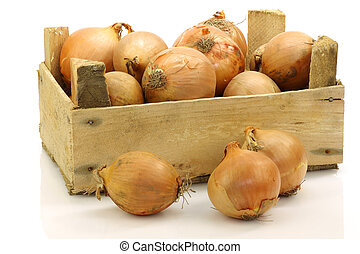 brown onions in a wooden crate