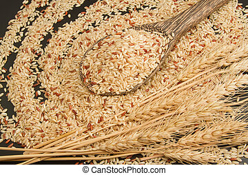 Brown organic rice on wooden spoon