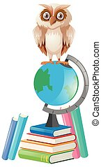 Brown owl standing on globe