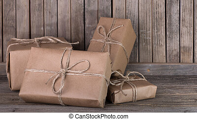Assortment of brown packages on a wood background