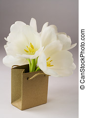Brown paper bag  with tulips