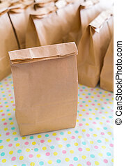 Brown paper bags on table . - Brown paper bags on table
