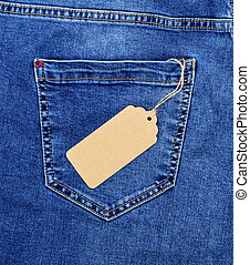 Brown paper blank price tag on rope against the back pocket of blue jeans