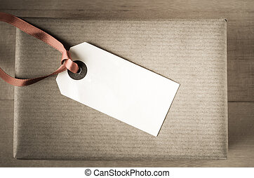 Brown Paper Gift with Label - Overhead shot of a neatly...