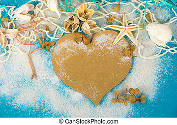 heart with seashells in sand