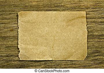 Brown paper on wood
