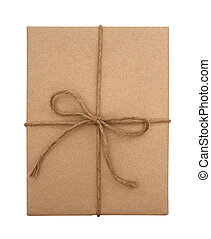 Brown paper package tied with string on a white background