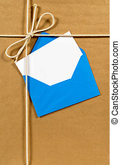 Brown paper parcel with blue envelope