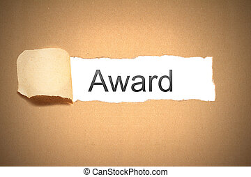 brown paper torn to reveal award