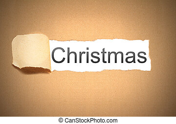 brown paper torn to reveal christmas