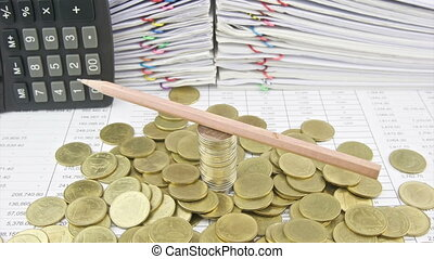Brown pencil rotate on stack silver and gold coins with pile...