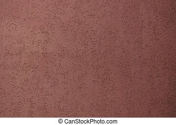 brown plaster texture on the wall of a building