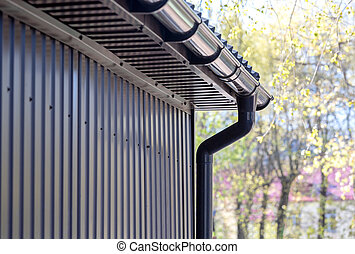 brown plastic downspout