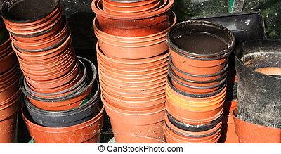 brown plastic plant pots