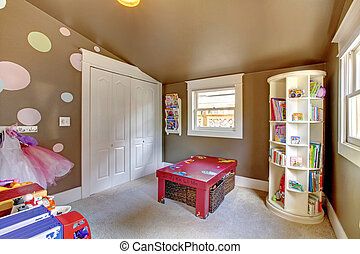 Brown play room kids girl interior with toys.