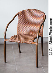 Brown rattan chair - Brown rattan and metal frame chair