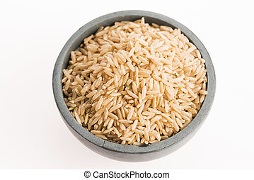 brown rice in a bowl isolated on white background