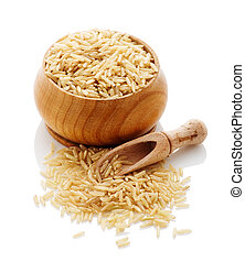 brown rice in a wooden bowl with a shovel on a white background.