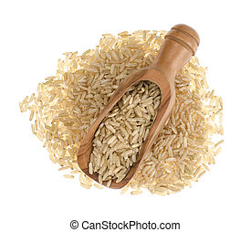 Brown rice in wooden scoop isolated on white background, healthy food