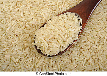 Brown rice in wooden spoon