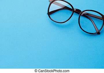 Brown-rim eyeglasses in empty background - Eyeglasses in...