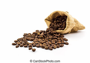 Brown roasted coffee beans in a canvas sack .