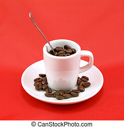 Brown roasted coffee beans in white cup