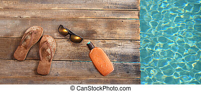 Brown sandals on withered wood