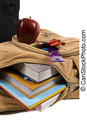 Brown School Back Pack full of school supplies and an apple...