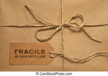 Brown shipping parcel tied with twine and tag for copy space...
