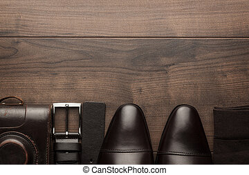 brown shoes, belt, socks and film camera - brown shoes, ...