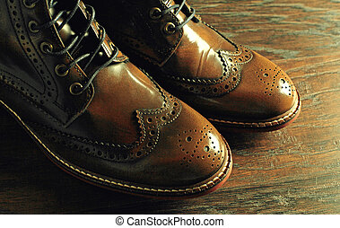 brown shoes on wood background - A pair of brown shoes close...