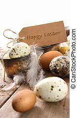 Brown speckled eggs  with easter card on wooden table