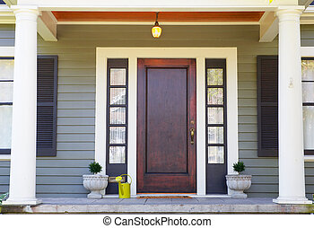 Brown stained Front Door on a home with bordering window and...