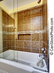 Brown stone tile shower with close up