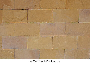 Brown stone wall for background design.