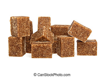 Brown sugar cubes on a white background