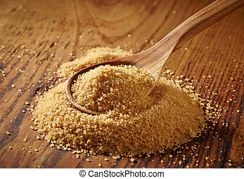 brown sugar heap on wooden table