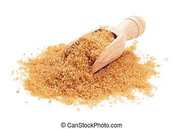 Brown sugar in scoop.