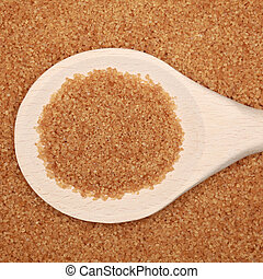 Brown sugar on a wooden spoon