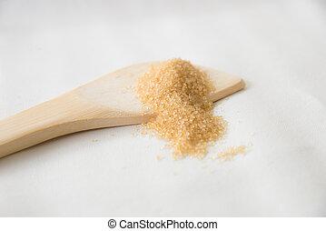 Brown sugar on white background.