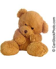 Brown teddy-bear - Sitting brown teddy bear over light...
