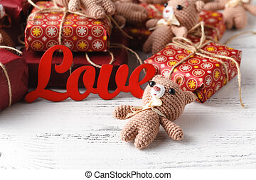 Brown teddy bears with red gift box on white