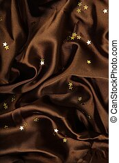 brown textile background with little golden stars