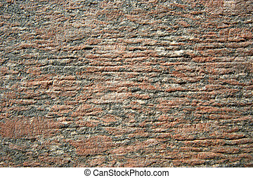Brown, textured, marble or granite wall background.