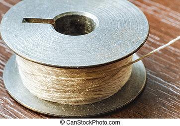 thread bobbin - brown thread bobbin macro closeup