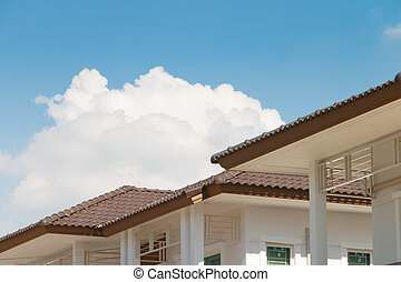 Brown tile roof on a new house