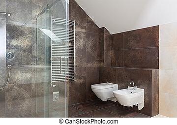 Brown tiles in modern bathroom