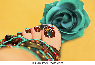 Brown turquoise design pedicure.