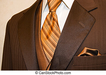 Brown Tuxedo - Rich brown tuxedo with bronze tie and vest.